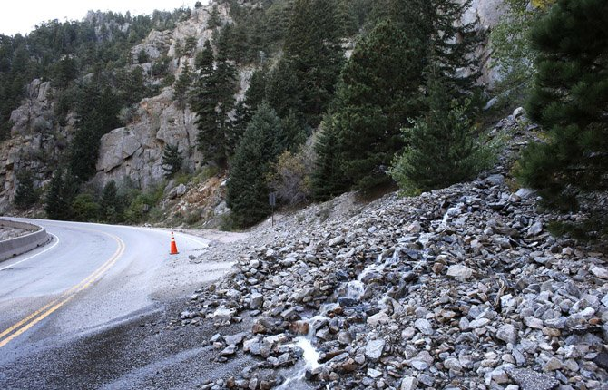 A rock slide partially blocks a closed canyon road, which links Boulder with the mountain town of Nederland, and which is damaged in places by recent flooding west of Boulder, Colo., Sept. 20. With snow already dusting Colorado's highest peaks, the state is scrambling to replace key mountain highways washed away by flooding. More than 200 miles of state highways and at least 50 bridges were damaged or destroyed, not counting many more county roads.