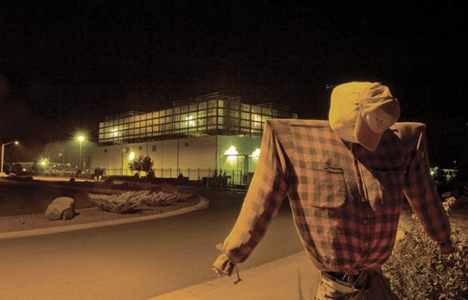 A scarecrow stands watch outside the fence of Google's complex in The Dalles. File photo