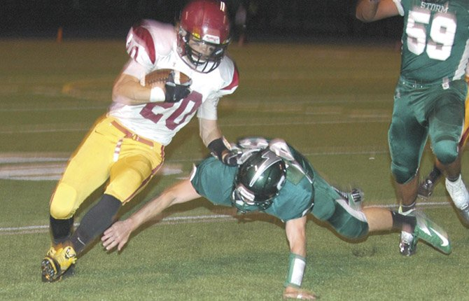 THE DALLES WAHTONKA Blake Diede are in action during Friday's non-league football game in Bend. TDW outscored Summit 28-7 in the second half in a 42-28 win.