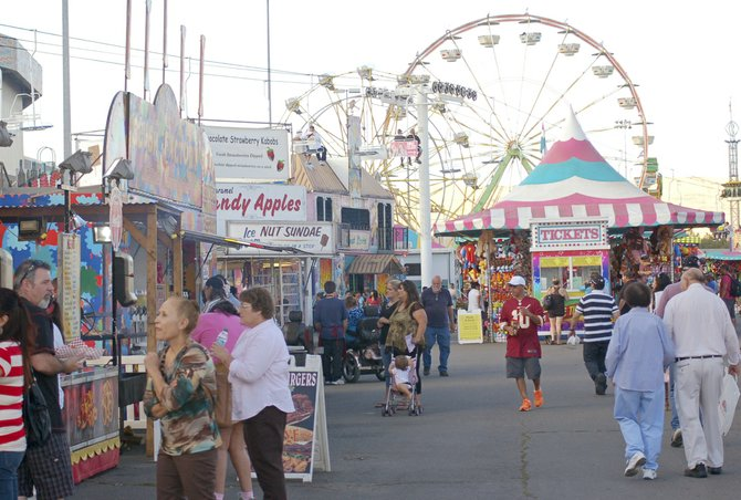 The Central Washington State Fair midway offers games, food and, of course, rides on the Ferris Wheel to get a bird's eye view of the fairgrounds. The carnival and midway will be open each day until 10 p.m. in Yakima at State Fair Park, through Sunday, Sept. 29.