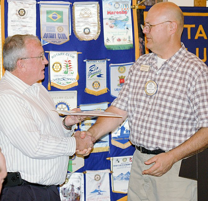 Sunnyside City Manager Don Day (L) is welcomed into the Sunnyside Noon Rotary Club by Rotarian Dan Huff at Monday's meeting. Day was a member of Rotary in New Mexico before he came to Sunnyside.