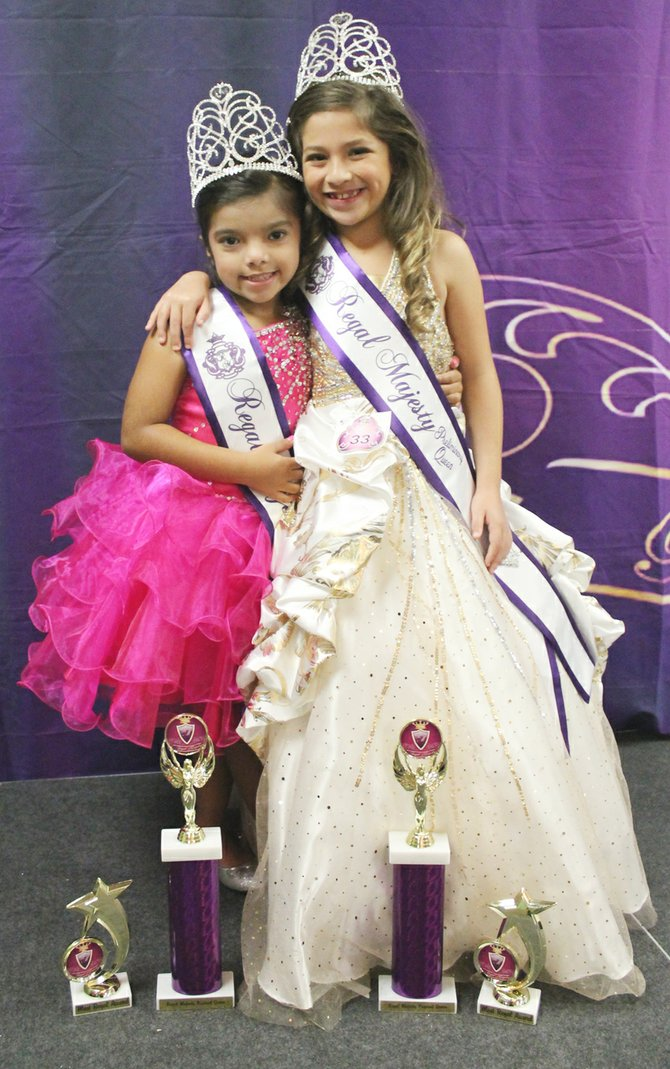 "This past Saturday Audrina Campos and Brianna Garza (L-R) traveled to Salem, Ore. to compete in a Regal Majesty Pageant. Campos won the title of queen in the 5-year-old age group. Garza also won the queen's title for her age group (7-9). Both girls also earned ""Most Regal"" titles and $50 discounts on their fees for the state competition in April. The next Regal Majesty pageant will be in Sunnyside on Saturday, Oct. 5."