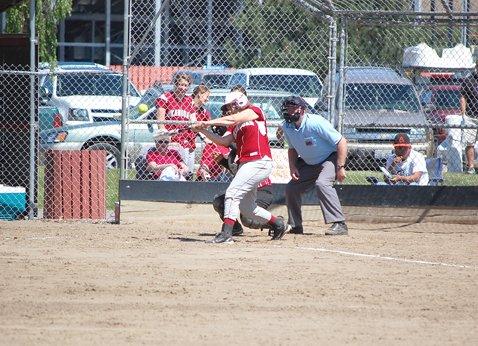 Sarah Gray of Okanogan rockets a hit against Omak on May 2.