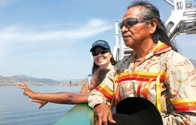 Sanpoil tribal elder GlenJames takes time to enjoy the view from aboard the new ferry on the Keller run following a christening ceremony Aug. 14.
