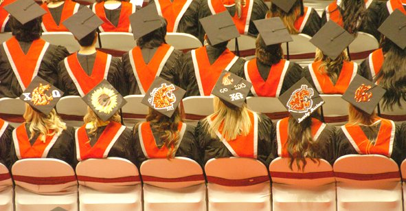 Graduates, above, show their Cougar spirit — and put forth other messages — in colorful ways. One woman, right, chose the scientific name for the school's mascot.