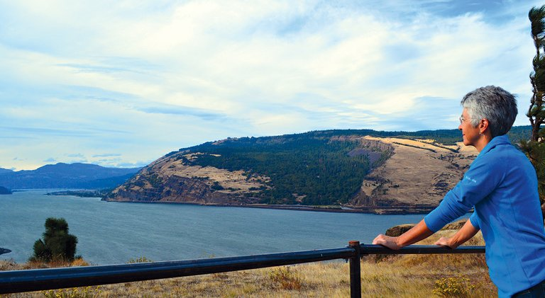 KATE MCBRIDE, land trust manager for Friends of the Columbia Gorge, walks along the Mosier Plateau Trail and pauses at a view point atop the plateau.