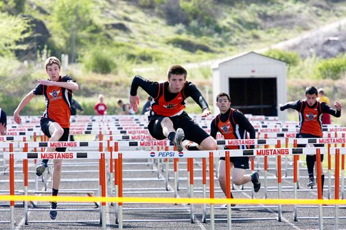 Bridgeport runners compete in the 110-meter high hurdles April 30. From left are Jamison Schroeder, Kip Craig, Tony Lozano and Michael Brown.