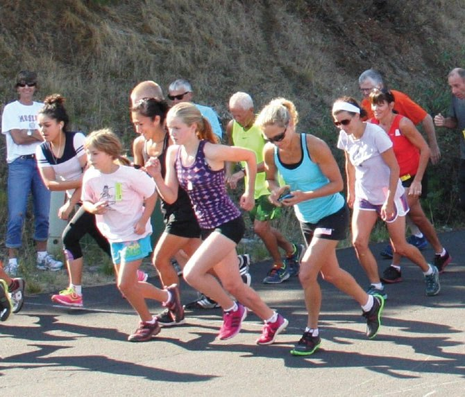 LOCAL HARRIERS bolt out of the blocks for the Twin Tunnels run/walk in Mosier. Sixty-five participants signed up with Charlie Remington winning the 12k men's race and Angela Krause placing first on the women's side.