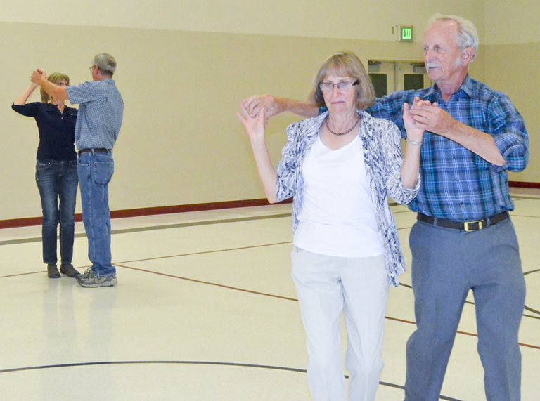 Jim Ide (far right) teaches ballroom dancing classes each Tuesday at the Grandview Community Center from 7 to 8:30 p.m. Pictured learning the steps to one of several dances this past Tuesday are Louise Fayette and Peter Chapman (at left) and Stephanie Foster with Ide.
