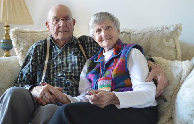 Andy Nilles, left, 93, and Gladys Salley, 90, discuss their relationship Sept. 19 in Sequim, Wash., as they prepare for their upcoming wedding in Port Angeles, Wash. Salley said she was initially attracted to Niles because of his car, a maroon 2007 Cheverolet HHR, but romance eventually blossomed.