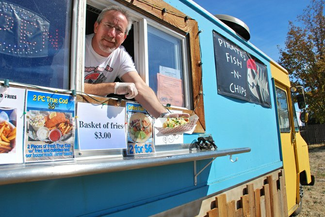 Richard Wilson serves up some fish tacos at his food truck, Pirates Fish and Chips in Bingen. The truck serves fish and chips, fish tacos, gyros, and a variety of other foods Tuesday, Thursday, and Friday between 10:30 am and 4:30 pm in the Bingen town lot.