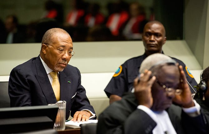 FORMER LIBERIAN President Charles Taylor, left, waits Sept. 26 for the start of his appeal judgement at the Special Court for Sierra Leone (SCSL) in Leidschendam, near The Hague, Netherlands. Judges at a U.N.-backed tribunual are delivering their judgment in Taylor's appeal against his convictions and 50-year sentence for planning and aiding atrocities by rebels in Sierra Leone's bloody civil war. Taylor, 65, became the first former head of state convicted by an international war crimes court since World War II when the SCSL found him guilty on April 26, 2012, of 11 counts of war crimes and crimes against humanity including terrorism, murder, rape and using child soldiers.
