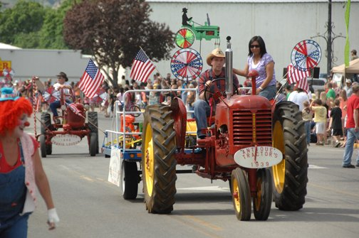 Travis Loudon drives a 1939 Massey Harris tractor in the annual May Festival parade Saturday.