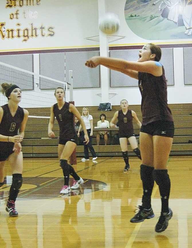 Lady Knight McKenzie Benjert (L) bumps the ball as teammates Kate Newhouse, Brittany Broersma and Katelyn Banks prepare for the next shot in Sunnyside Christian's match against the Klickitat Vandals last night. The Lady Knights won in three hard-fought sets, 27-25, 25-21, 25-21. Benjert was 21-for-22 from the service line, Broersma had 10 kills and Newhouse dug up the ball seven times on the night. The undefeated Lady Knights will be hosting Yakama Tribal next Tuesday, Oct. 1.