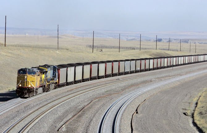 A COAL TRAIN travels in northeast Wyoming near Gillette. Tough new limits on the amount of heat-trapping emissions new power plants can emit proposed by the Obama administration earlier this month will likely accelerate a shift away from coal-fired power and toward electricity generated with natural gas, wind, and sunshine.