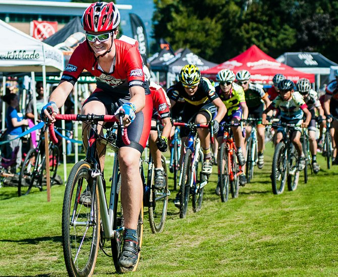 MOUNTAIN VIEW CYCLES team racer Micah Melkonian smiles as he completes a lap in the 2013 Hood River Double Cross earlier this month at HRVHS.