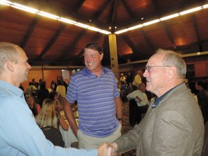 Shawn Meyle (left) and Roy Nellermoe meet and talk with Hall of Fame inductee Roger Baker, center, Wy'east High School Class of 1964, who played for the 1972 and 1976 U.S. Olympics team handball squads. In Baker's remarks later that night he encouraged all athletes to continue the bonds that form in high school athletics.