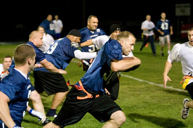 PIG BOWL 2013 is Saturday in The Dalles. Below, Dono-van Doroski is one of two beneficiaries for this year's fundraiser football event be-tween Oregon and Washington law en-forcement officers.
