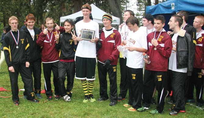 THE DALLES WAHTONKA cross country harriers display their first-place trophy after competing in Friday's Bridgette Nelson Invitational at Sorosis Park in The Dalles. TDW had five athletes finish in the top-9 led by Elijah Kohltfarber, who had a time of 18 minutes and 19.7 seconds for second place.