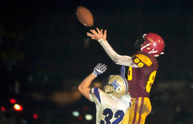 The Dalles Wahtonka senior Austin Dehart, right, intercepts a pass to Hermiston senior C.J. Flores in The Dalles Friday, Sept. 27.