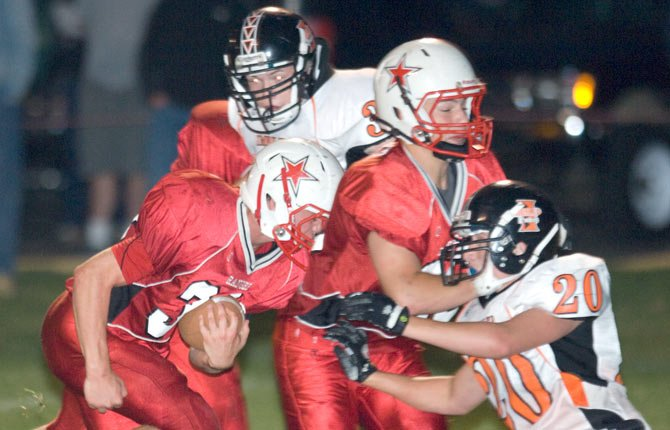 DUFUR running back Trever Tibbets follows his blocks for big yardage in a 1A football game this year.