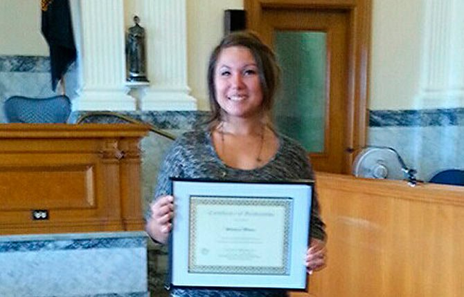 SHANAY MOORE holds up her certificate at the Sept. 23 graduation from Family Dependency Court. Contributed photo