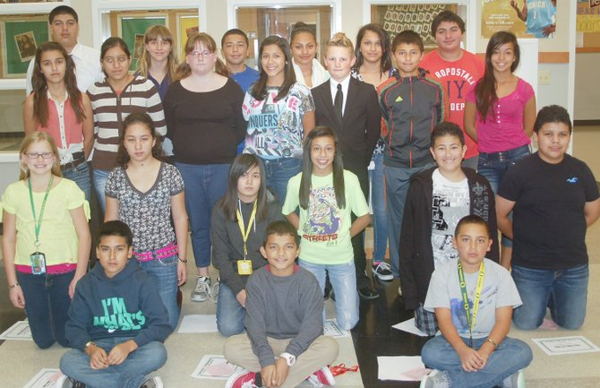 Sunnyside's Sierra Vista Middle School students of the month for September are (back row L-R) Marcos Macias, Adia Curfman, Saul Ramirez, Briana Granados, Nalleli Magallon and Jaime Bajonero; (third row L-R) Angie Sanchez, Maria Narravo, Sydney St. Arnold, Karen Villanueva, Derek Weaver, Christian Martinez and Nora Cisneros; (kneeling L-R) Arizona Rodriguez, Brenda Hernandez, Alexis Campos, Dallas Borrego, Markus Sanchez and Victor Cruz; (sitting L-R) Brian Galicia, Nathan Gomez and Jesse Gonzales.  (Not pictured: Erik Birrueta.)