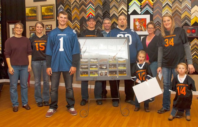 The 2013 Pig Bowl raised $30,000 to be split between two recipients, Kadee Herrington and Donovan Doroski. At a formal presentation at Westwind Frame and Gallery on 2nd Street in The Dalles, the duo was each presented with a check, coffee coupons from Dutch Bros. and a framed picture collage from Saturday's festivities. Pictured (from left to right), are board members, Jennifer Holloran, Melissa Wykes, recipient Donovan Doroski, board members Randy Wells, Michael Holloran, Curt Harth, Tammy Keys and recipient Kadee Herrington with her children, Dilynn and Jordynn. In the 11 years of existence, the Pig Bowl organization has raised $149,865.37 for families in need.