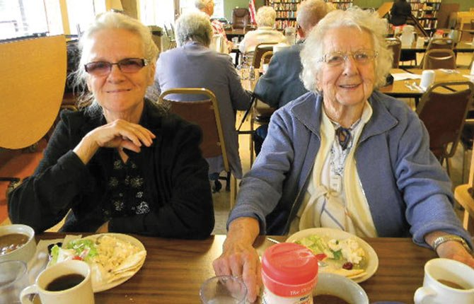 Shirley Carlson, left, and Kathryn Olmstead enjoy a meal and company during the Meals on Wheels lunch at the Mid-Columbia Senior Center.