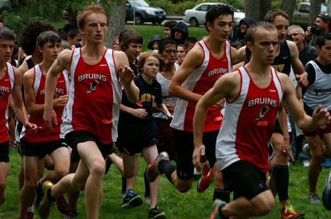 Columbia High's Nathan DeVaney (left), Hayden Gibson, and Cabot Roe head for the front of the pack during the start of last Friday's Bridgette Nelson Invitational Cross Country Meet at Sorosis Park in The Dalles.