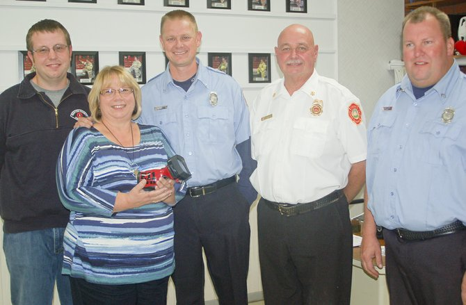 The family of the late Bill Timmermans was on hand at last Wednesday's Sunnyside Fire Department drill night to admire a thermal imaging camera purchased with money given in memory of the 36-year volunteer fireman. Pictured (L-R) are David Timmermans, a volunteer with Benton County Fire District 1, Linda Timmermans, holding the newly acquired thermal imaging camera, Sunnyside Volunteer Fireman Chad Werkhoven, Sunnyside Deputy Fire Chief Lloyd Hazzard and Sunnyside Volunteer Fireman Woody Clouse.
