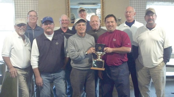 LOCAL golfers (pictured from left to right) Ron Krol, Dave Link, Bob Fimple, Bill Sallee, Jim Ferrer, Pete Kelly, Tom Krueger, Dan Telles, Dale Griffiths and Ray Shepherd pose with a trophy earned at the 2013 Gorge Cup event. The team competed against some top golfers from the area. Not pictured are Pat Martin and Fred Stampflee.         Contributed photo