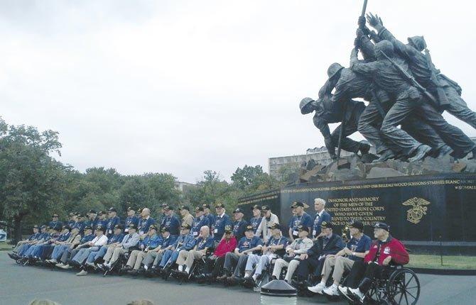 Norton and fellow veterans visit the Marine Corps Memorial.