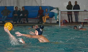 Myles Cameron defends a Sandy player in water polo action.