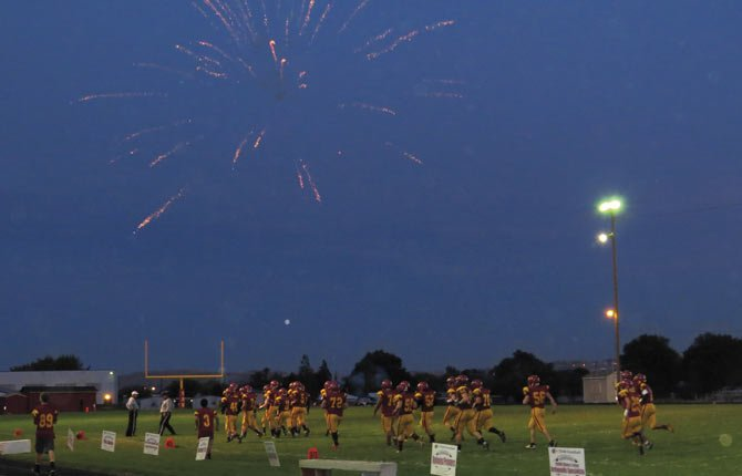 FIREWORKS EXPLODE over Sid White Field Oct. 4 as The Dalles Wahtonka Eagle Indians prepare to play their homecoming game against the Ridgeview Ravens.
