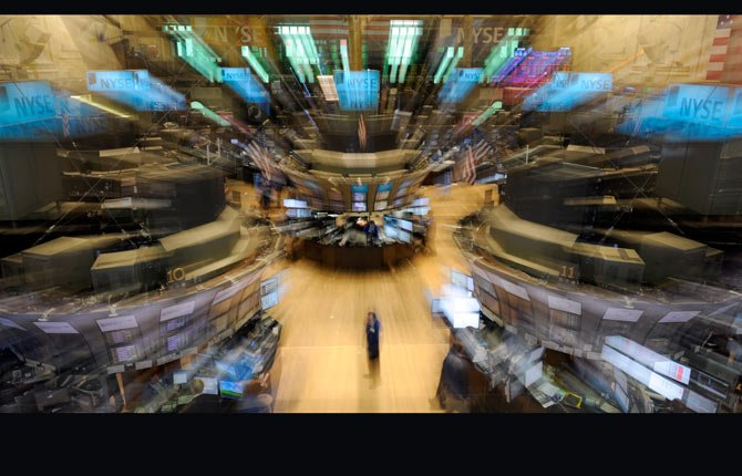 In this Thursday, Aug. 19, 2010, file photo shot with a zoom lens, traders work on the trading floor of the New York Stock Exchange, in New York. Investors