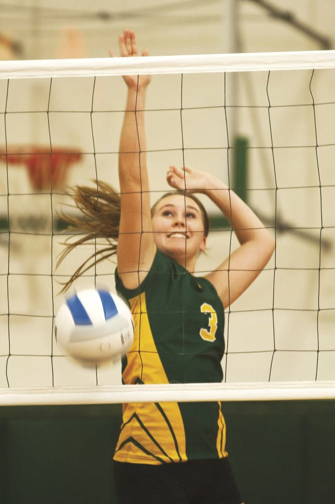 SWC volleyball player, Roxanne O'Neal, makes a block in a recent match in Moro. Monday in Redmond, SWC swept Central Christian in three.