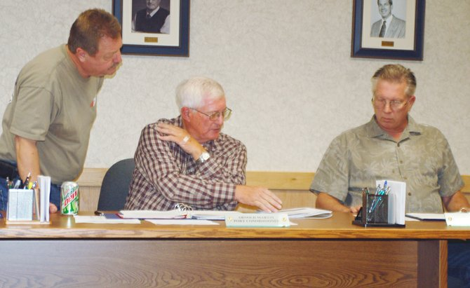 Port of Sunnyside Commissioners (L-R) Jim Grubenhoff, Arnold Martin and Jeff Matson review preliminary designs for an anaerobic digester that when constructed will double the port's capacity to handle industrial wastewater.