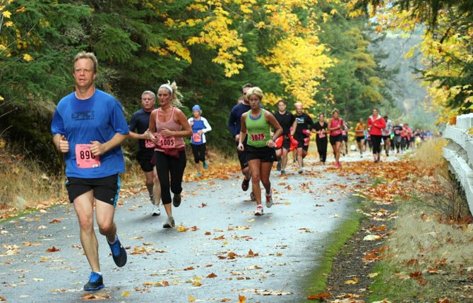 LOCAL HARRIERS hit the pavement for the Columbia Gorge marathon last year. Starting on Oct. 27, large numbers expected to turn out in Hood River for the fifth annual running extravaganza.