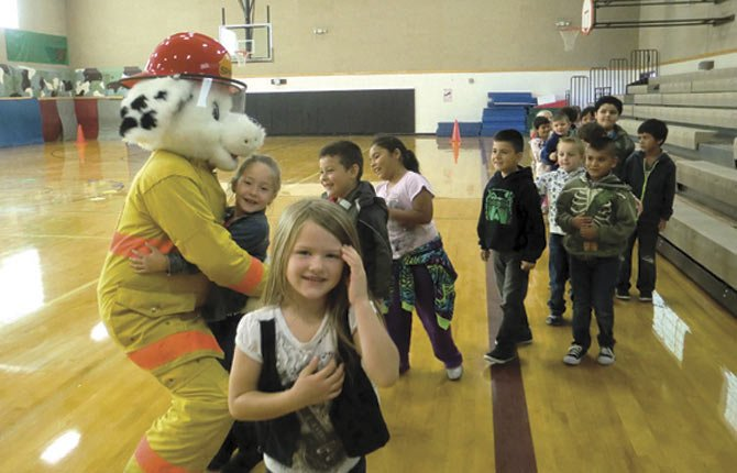 Chenowith Elementary School students greet Sparky the Fire Dog.