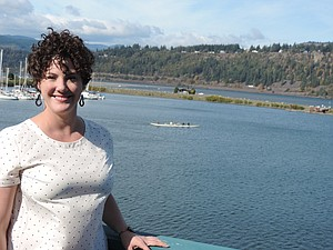 ASHLEY HUCKABY takes a break on the deck overlooking Hood River Marina.
