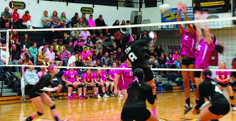 WEARING PINK for Breast Cancer Awareness Month, the HRV girls host-ed The Dalles Thursday evening. Pictured here are Jestena Mattson and Jennifer Pack-er going for a block in the game.