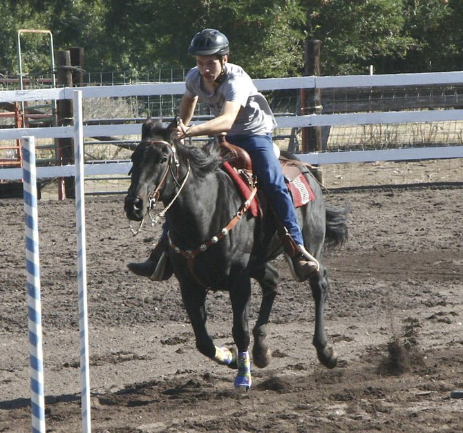 THE DALLES WAHTONKA equestrian Jacob Richman competes in the pole bending event at this past weekend's Play Day at The Dalles Riders Club.              Contributed photo