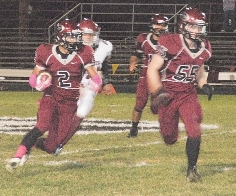 Grandview's Lorenzo Sanchez looks for running room as teammate Zach Schloss (55) prepares to block a would-be tackler.
