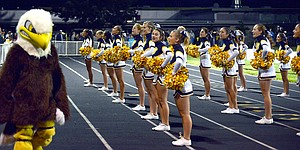 HRV CHEERLEADERS rally the crowd during a Friday night home football game. The team will be traveling to Hermiston on Oct. 18, and The Dalles on Oct. 25 for football.