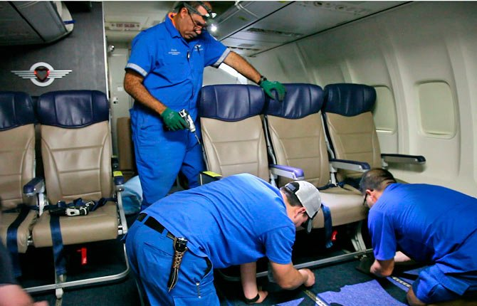 Southwest Airlines aircraft technicians install newer, skinnier seats on a 737 at the carrier's headquarters in Dallas. Southwest says passengers will have the same amount of legroom even though the new seats allow for another row onboard.