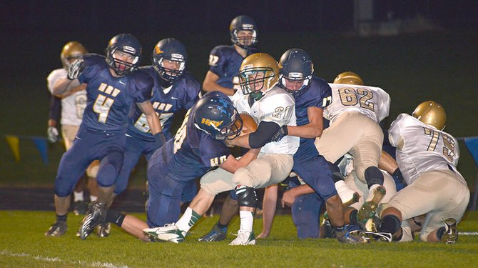 Steven Swafford and Jackson Hukari team up for a tackle.
