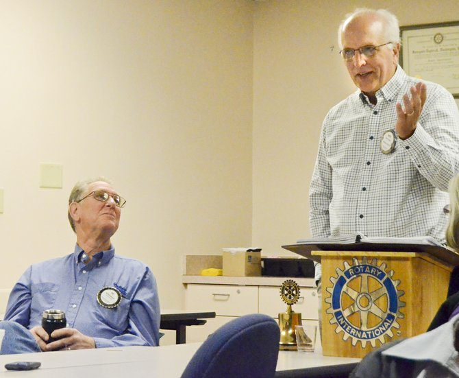 Sunnyside Daybreak Rotary Club President Nick Friend (standing) introduces the video presentation at Wednesday's meeting.
