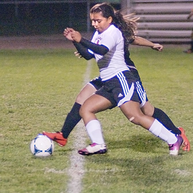 Sunnyside's Aylin Bautista (foreground) battles a Davis defender for the ball during the Lady Grizzly soccer team's home loss last night.
