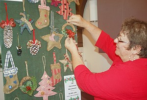 Granger Historical Society member Elissa Simonson displays a few of the country Christmas ornaments she created to benefit the Granger museum. These items and more will be available at the Granger
